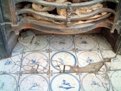 Damaged fireplace tiles